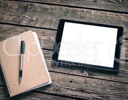 Tablet with ring binder on desktop