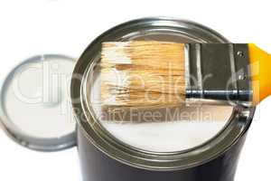 Brush and open paint pot