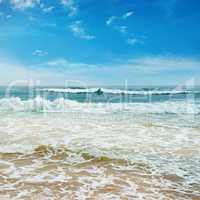 Ocean waves and blue sky