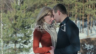 Couple in love in the winter forest