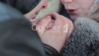 boyfriend warms hands sweetheart, frozen in the cold