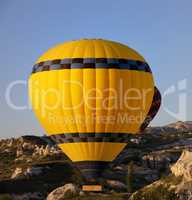 Hot air balloons in mountains at early morning