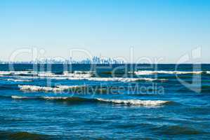 Waves breaking on lake with Toronto skyline in distance