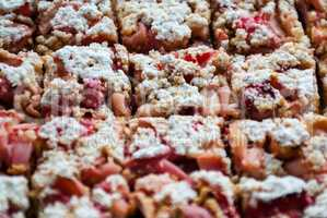 Cut rhubarb cake sprinkled with powdered sugar