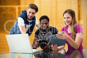 Composite image of creative young business team looking at digit