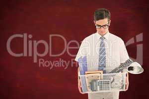 Composite image of fired businessman holding box of belongings