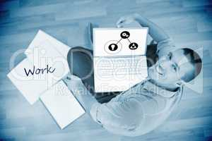 Work  against young creative businessman working on laptop