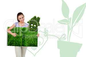 Composite image of woman pointing lawn book