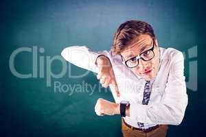 Composite image of geeky businessman pointing to watch