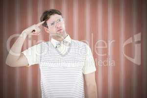 Composite image of geeky hipster thinking with finger on temple