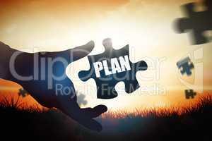 Plan  against orange sunrise