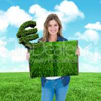 Composite image of woman holding lawn book
