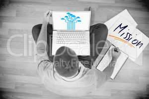 Mission against young creative businessman working on laptop