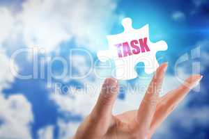 Task against bright blue sky with clouds