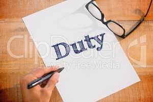 Duty against left hand writing on white page on working desk