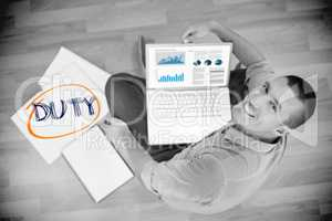 Duty against young creative businessman working on laptop