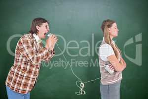 Composite image of geeky hipsters using string phone