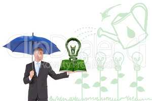 Composite image of man holding umbrella and lawn book