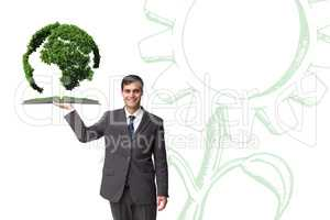 Composite image of man holding up lawn book