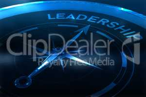 Composite image of compass pointing to leadership