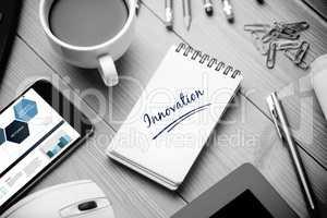 Innovation  against notepad on desk