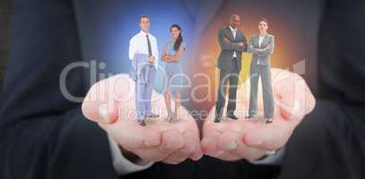 Composite image of businessman and a woman with their hands cros