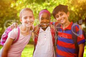 Composite image of little school kids in school corridor