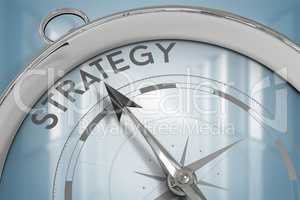 Composite image of compass pointing to strategy