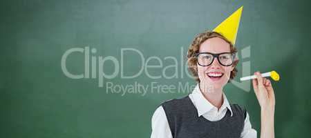 Composite image of geeky hipster in party hat with horn
