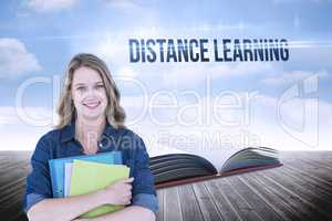 Distance learning against open book against sky