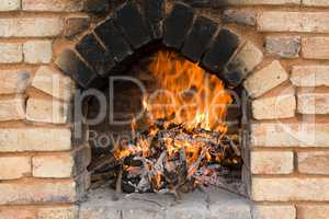 Fireplace with fire and embers