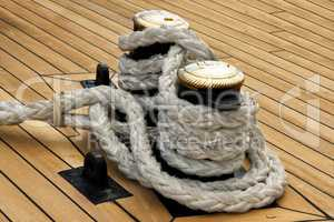 Ship interior, rope on old wood deck.