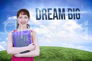Dream big against green hill under blue sky