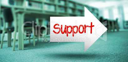 Support against volumes of books on bookshelf in library
