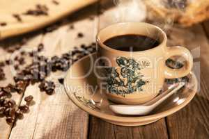 Traditional style Hainanese coffee in vintage mug