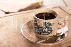 Traditional kopitiam style Nanyang coffee in vintage mug