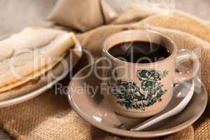 Traditional Malaysian Chinese dark coffee and breakfast