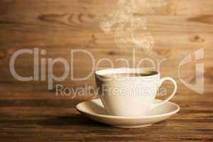 Steaming hot coffee in white mug