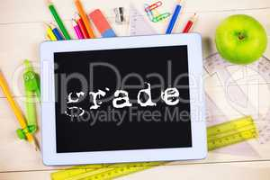 Grade against students table with school supplies
