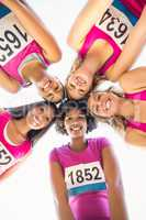 Five smiling runners supporting breast cancer marathon