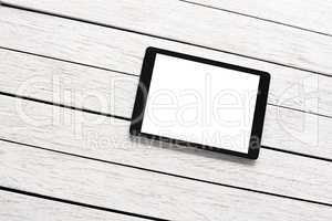 Tablet computer on white wooden desk