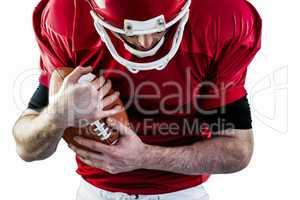 American football player protecting football