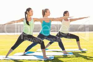 Sporty women stretching on exercise mat
