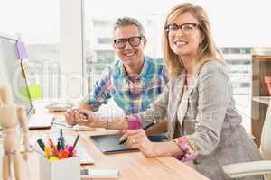 Working creative design team smiling to camera