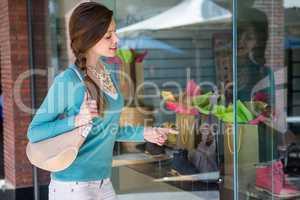 Woman looking at shop window