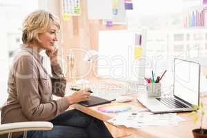 Casual designer working at her desk