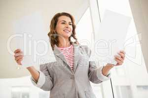 Casual businesswoman holding papers