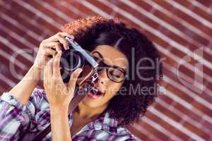 Attractive hipster photographing with camera