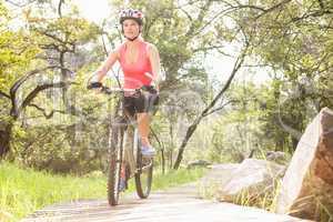 Blonde athlete mountain biking