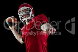 American football player throwing football